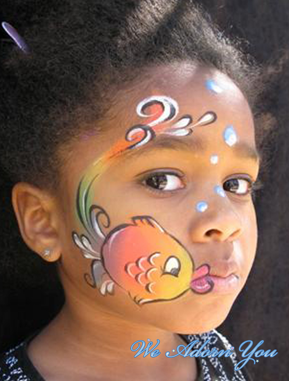 Face Painting Rainbow Fish- We Adorn You.jpg