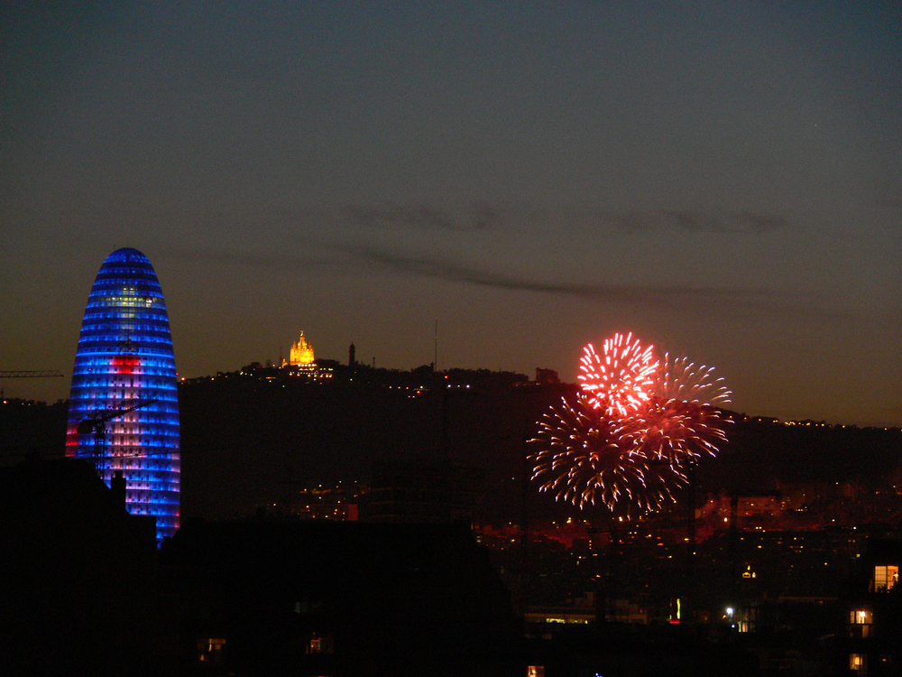 Barcelona. View of Agbar Tower and Tibidabo from Poblenou during La Mercè festivities.