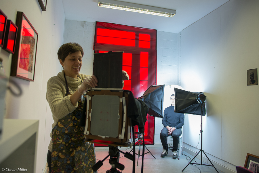 "Almudena Romero making collodion plates at her studio in East London for her project ""Growing Concerns"" about immigrants to UK. With JC Candanedo (Grey Pistachio)."