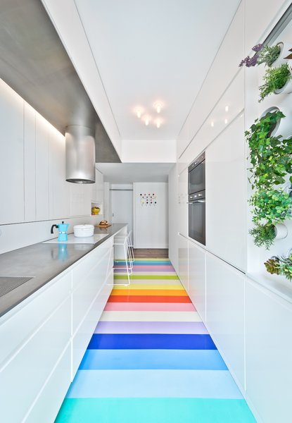in-the-kitchen-a-mini-vertical-garden-provides-fresh-aromatic-herbs-thanks-to-a-mix-of-direct-sun-and-specialized-artificial-lighting-a-vibrant-rubber-floor-leads-the-eye-forwa.jpg