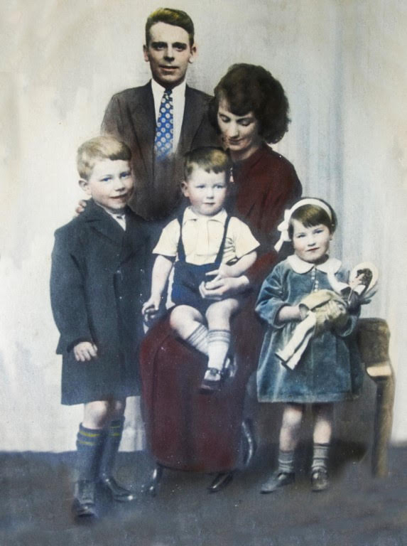 An image of George and his family taken in the 1930's