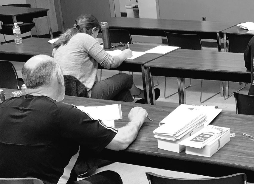 Students completing the final written exam after the 16-hour, 2-day UAV Ground School Course offered by M3 Aerial Productions.