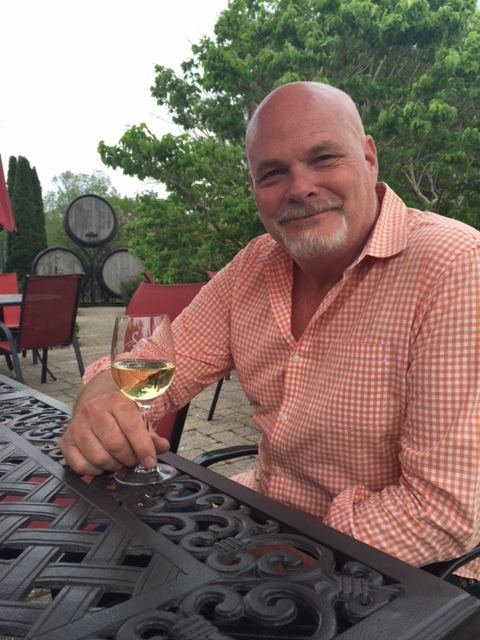 Jeff Hundertmark, head winemaker at Stoney Ridge and Mike Weir wineries, sips a glass of Ahead by a Century.
