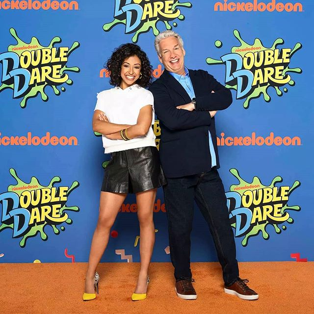 Double Dare is coming back to @nickelodeon June 25th! Here's the two hosts @lizakoshy and @therealmarcsummers in front of a step and repeat I designed 🙃  #nickelodeon #doubledare #lizakoshy #marcsummers #stepandrepeat #orangecarpet #design #nostalgia #gameshow #instagood #reboot