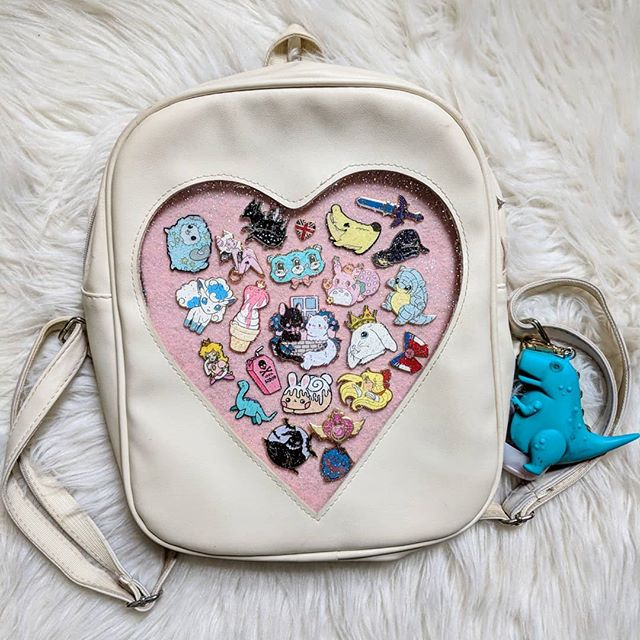 Finally updated my bag a little more with some new pins ✨  Makers tagged!  #ita #itabag #pins #pindesign #flair #purse #cute #insert #pink #instagood #heart #fur #aesthetic #backpack #pincollection #pincollector