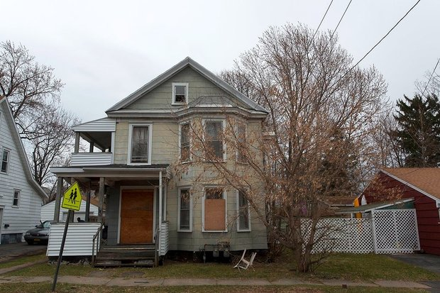 A vacant home owned by the Syracuse Landbank at 301 Loomis Ave. will have its window boards painted by local students as part of a city-wide art project the Landbank is beginning.  (provided by Logan Reidsma)