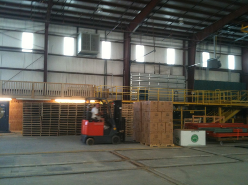 Operations Manager Johnny using the forklift to transfer palette's around the warehouse