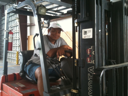 Brian Reesee commanding the forklift, one of his many talents
