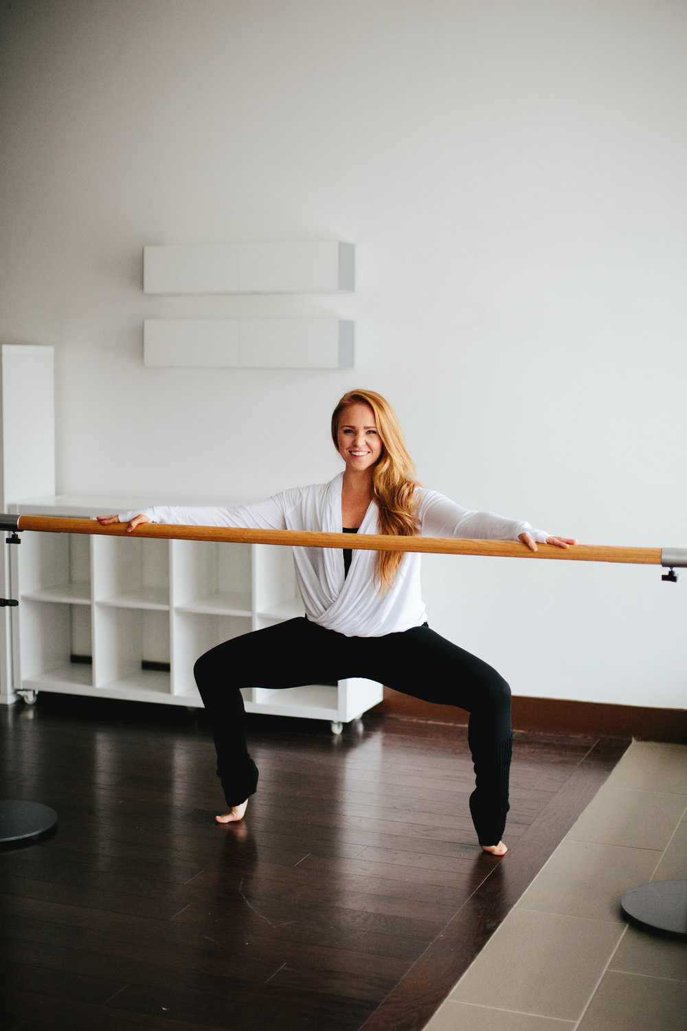 Horse Pose with a heel lift shown by one of our Raising the Barre instructors, Charlee.