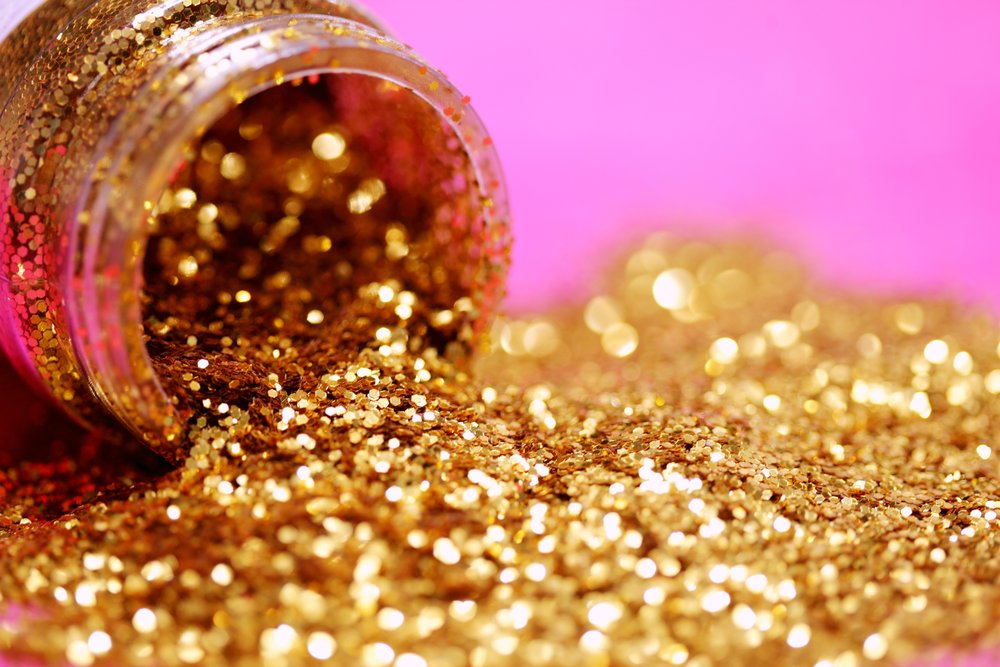 Spilled jar of gold glitter.