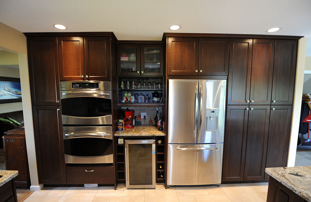 Large pantry storage with built in bar and wall ovens