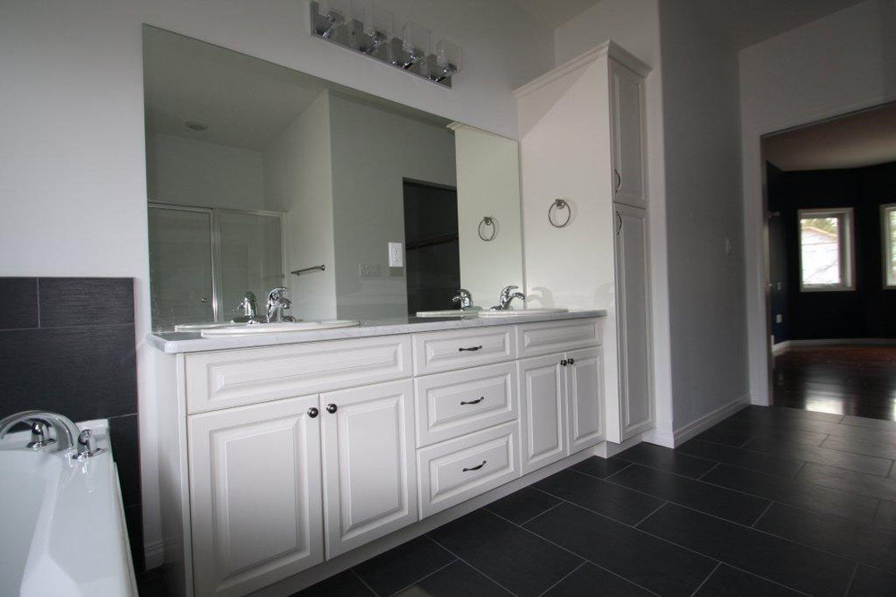 Traditional white painted vanity with countertop