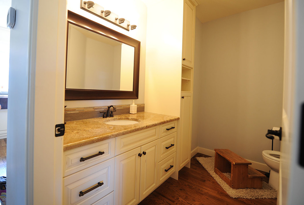 White painted vanity with granite countertop