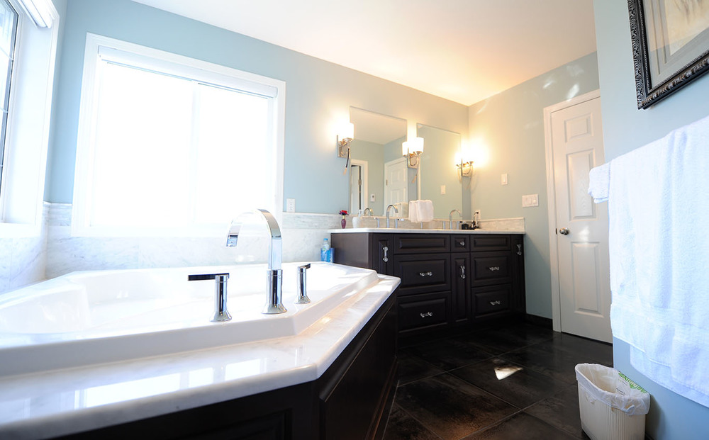master bathroom with black painted vanity