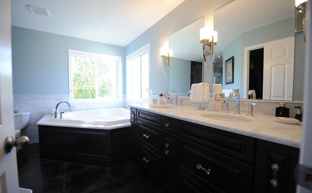 master bathroom with black painted vanity