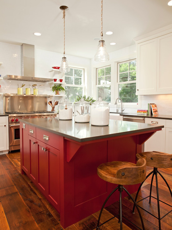 Feature Island - One of the most common ways we see strong colors like red used is as a feature peice in the cabinetry, for instance like this island.