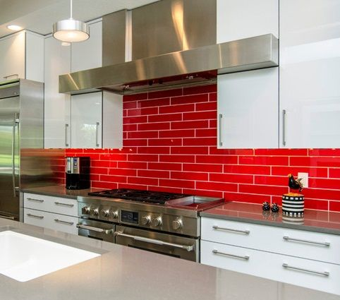 Backsplash - Use your backsplash as a feature space and bring in a bold brick style red.