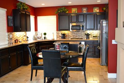 Wall Color - Who said the cabinetry had to be red? Try painting a single accent wall, or all the walls a bold red!