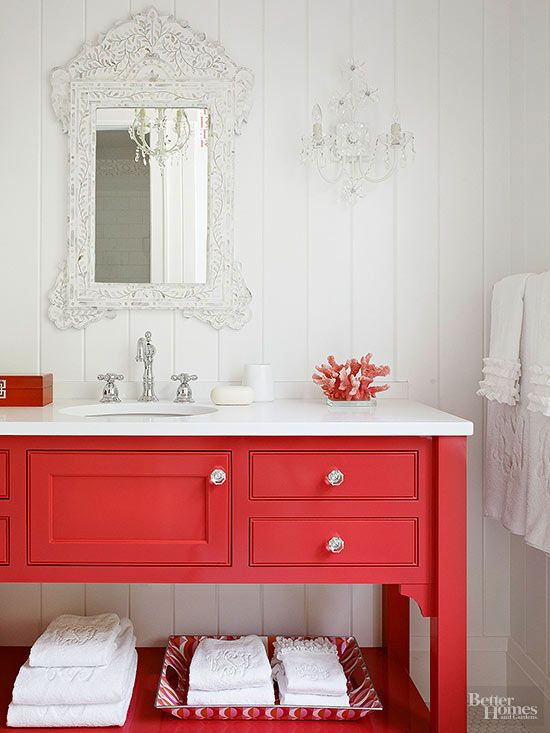 Bathroom Vanity - Why not start small with one of the bathroom vanities? This look is pulled together with the antique mirror, chandelier sconce and vintage towels.