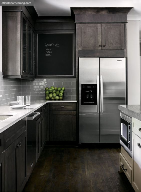 Dark Stain - Pair a dark gray stain with a medium gray subway tile backsplash for a cozy kitchen.