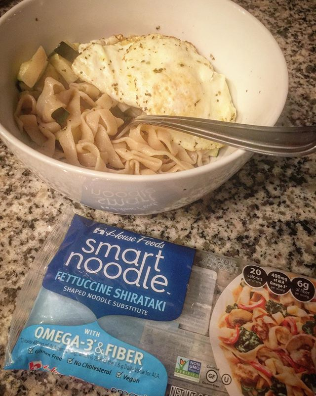 Round 1🍽  Testing out noodle alternatives! 🍝 @housefoodsamerica  Yes these are known as the 'smelly' noodles but there are some tricks to perfected them! 🙌🏻 RINSE! Rinse them... for a long while. I put them in strainer and allowed cold water to bath them for about 5-10 minutes. While my water boiled 💧 Add to boiling water 3-4 minutes. Strain. I added Italian seasoned zucchini and chicken. A little extra olive oil to coat! Tasted delicious and I didn't miss the carbs at all! First round A plus! Thanks @housefoodsamerica 💯