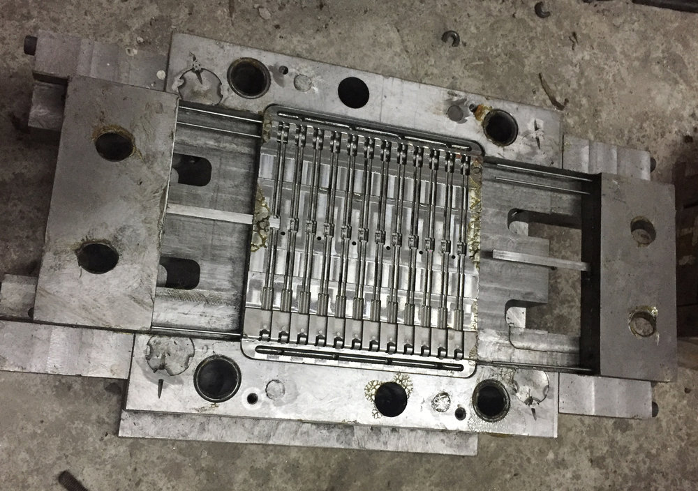 Centre Rib Over Mold Tool (1 of 17 Tools) - Completed with Sliders, Ejector Pins, and Cooling Channels