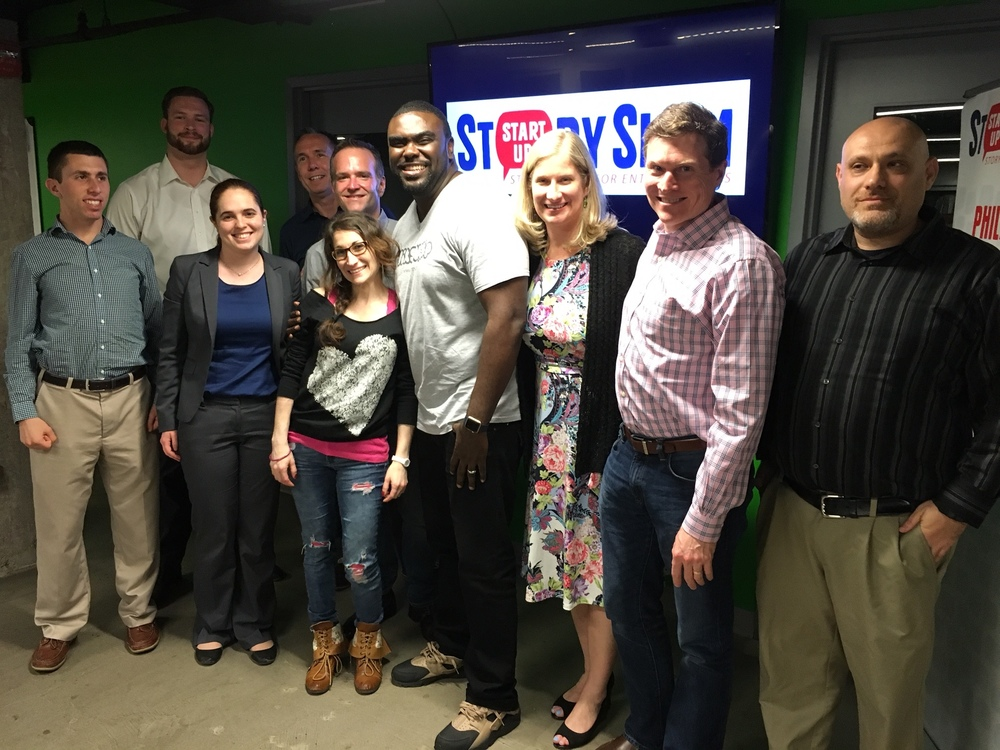 Storytellers from the first ever Washington DC StartUp StorySlam posed together at MakeOffices.