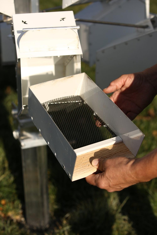 Nest tray slides out for nest checks