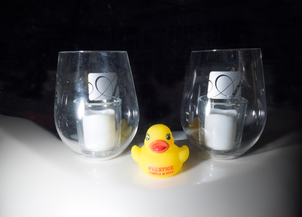 A rubber ducky enjoying a few glasses of wine on a South Seas Spa (above) and a picturesque setting of a South Seas Spa in our showroom (right).   Stop by our location to check out pricing and options, along with ideas for installing a hot tub in your backyard today.