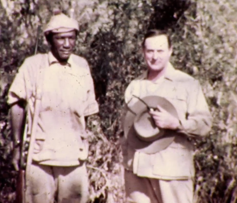 John Alexander (J.A.) Hunter, grandfather of Alex Hunter, posing with a member of the camp staff during the 1937 Sykes safari