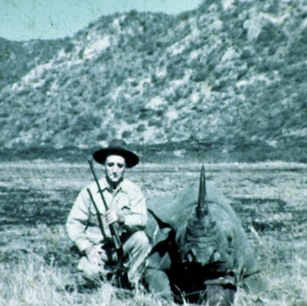 Sykes family patriarch Howard poses with his first rhino kill of the safari, 1937