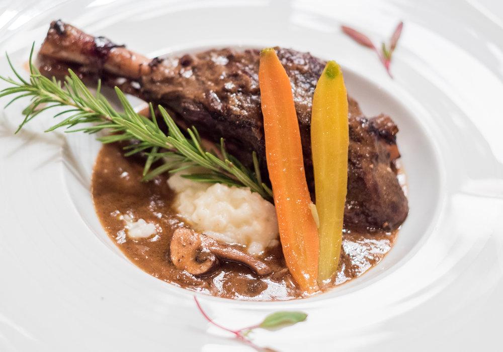 Lamb shanks Bourgeon, parmesan risotto and seasonal vegetables.