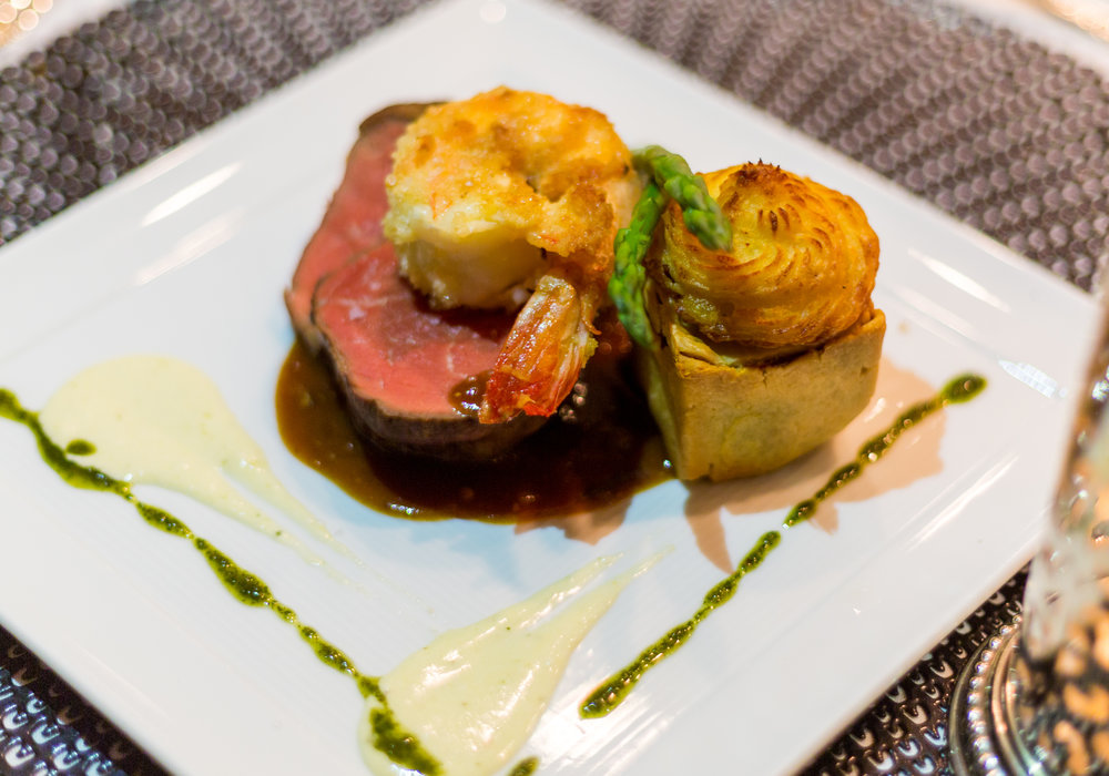 Slow roasted filet mignon and seared shrimp surf and turf, porcini mushroom pie with horseradish emulsion.