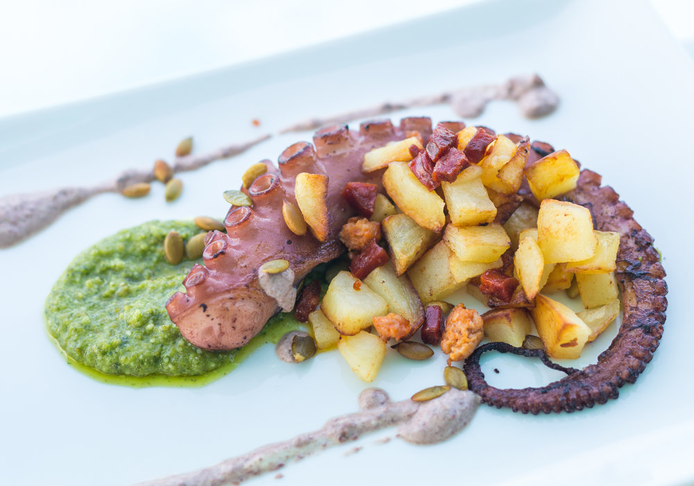Braised and charred grilled Spanish octopus with chorizo, pepita-lime pesto, cannellini bean purée and sautéed potatoes.