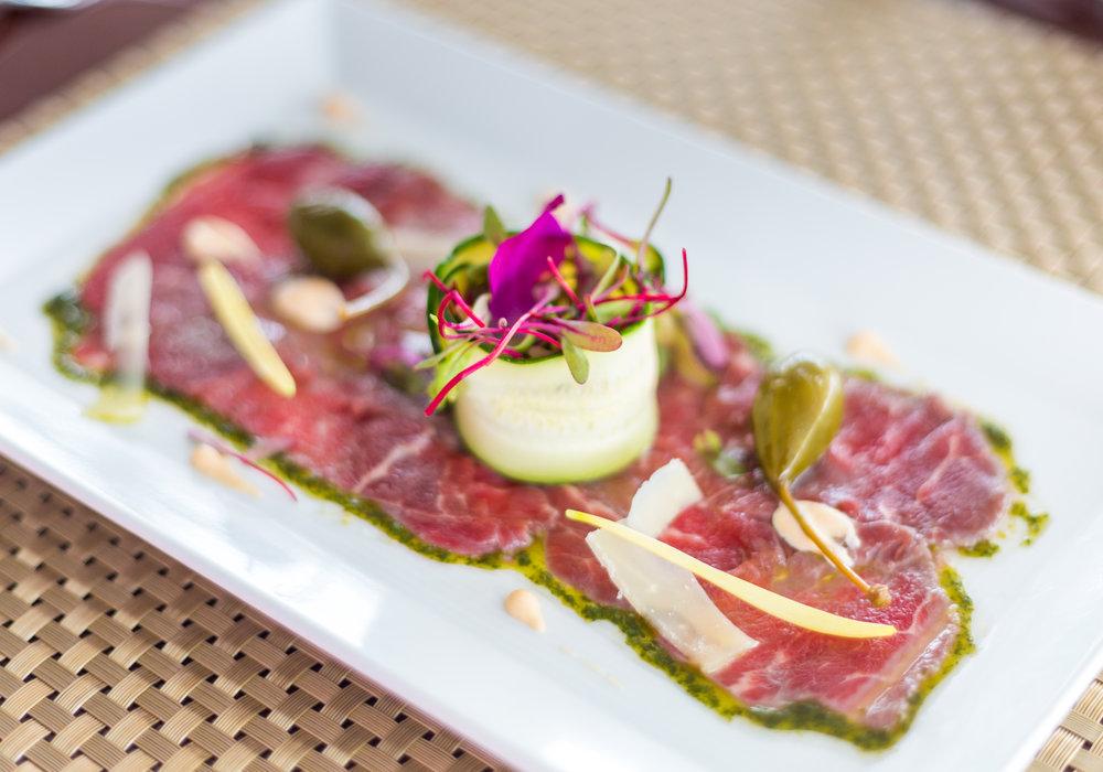 Beef Carpaccio, garlic aioli and arugula salad.