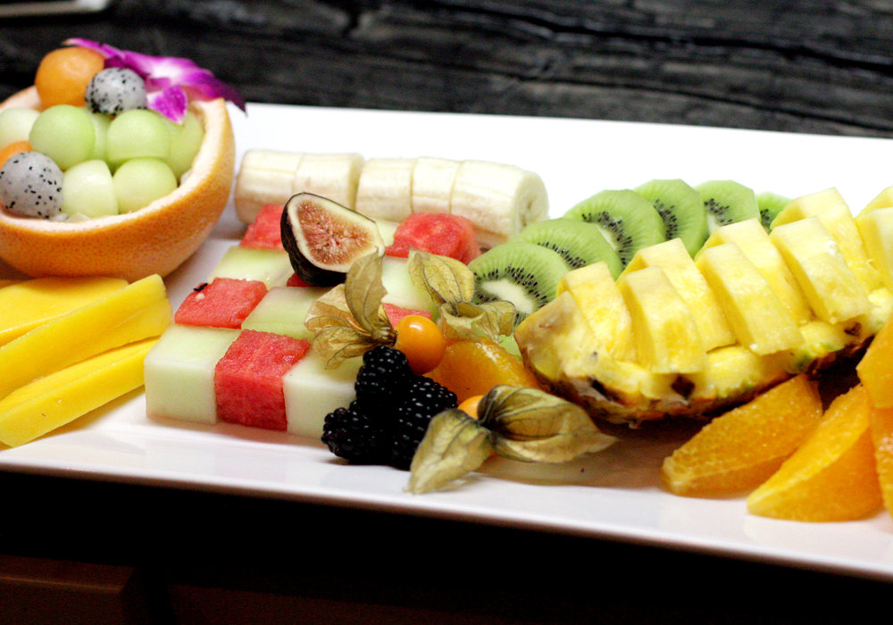 Tropical fruit breakfast platter with watermelon and canteloupe chess board.