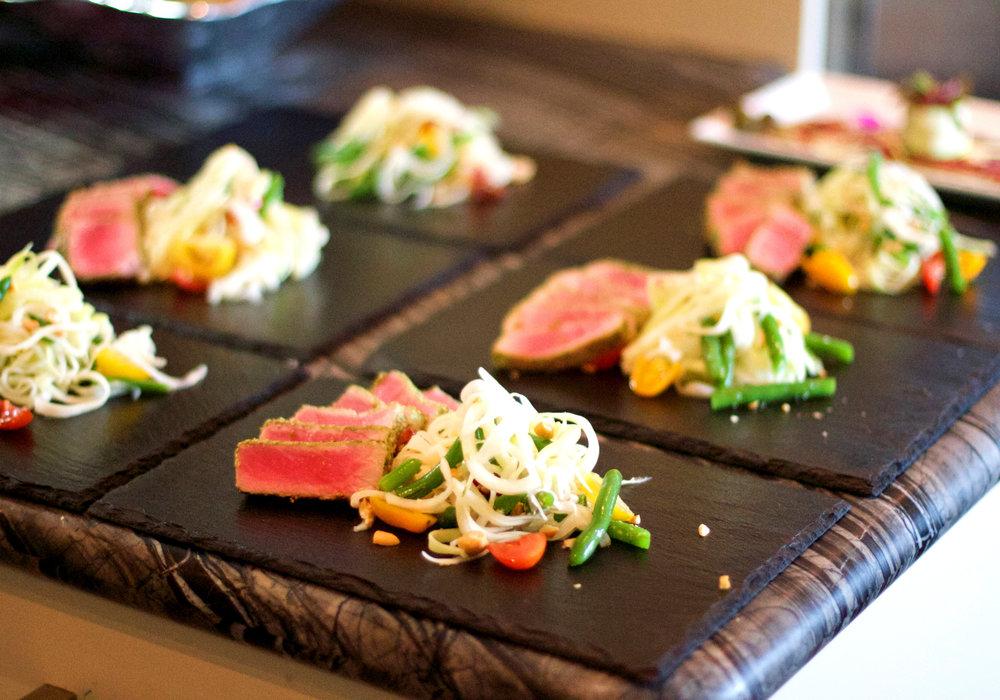 Seared yellow fin tuna, thai papaya salad, avocado and mango salsa.
