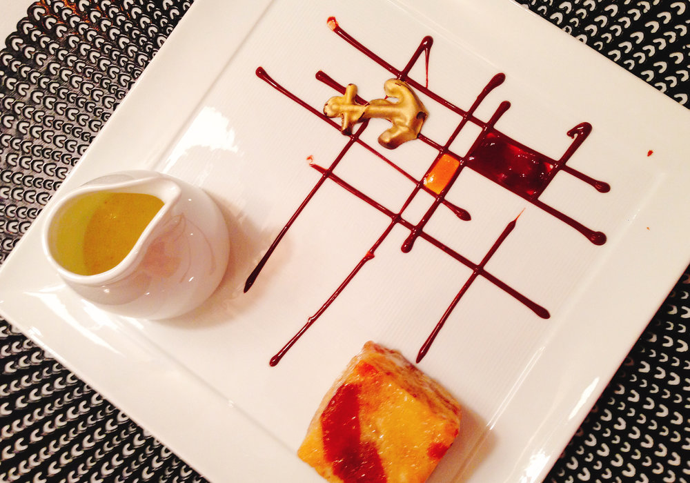 White chocolate and Captain Morgan bread pudding with creme anglaise and a chocolate anchor.
