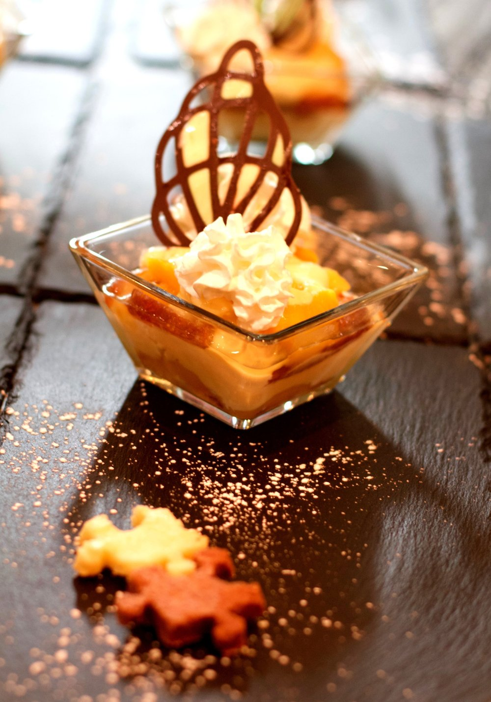 Mango triffle with cream, chocolate ganache and jigzaw puzzle biscuits.
