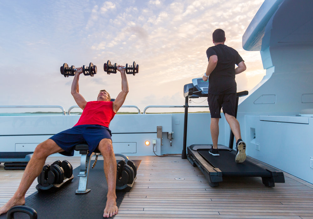Stay fit and healthy while on charter with sundeck workout with weights, treadmill and more