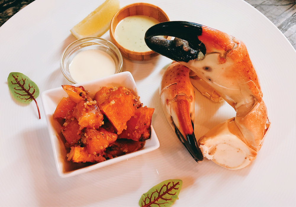 Stone Crab Claw with Roast Sweet Potato and Qunioa and dipping sauces