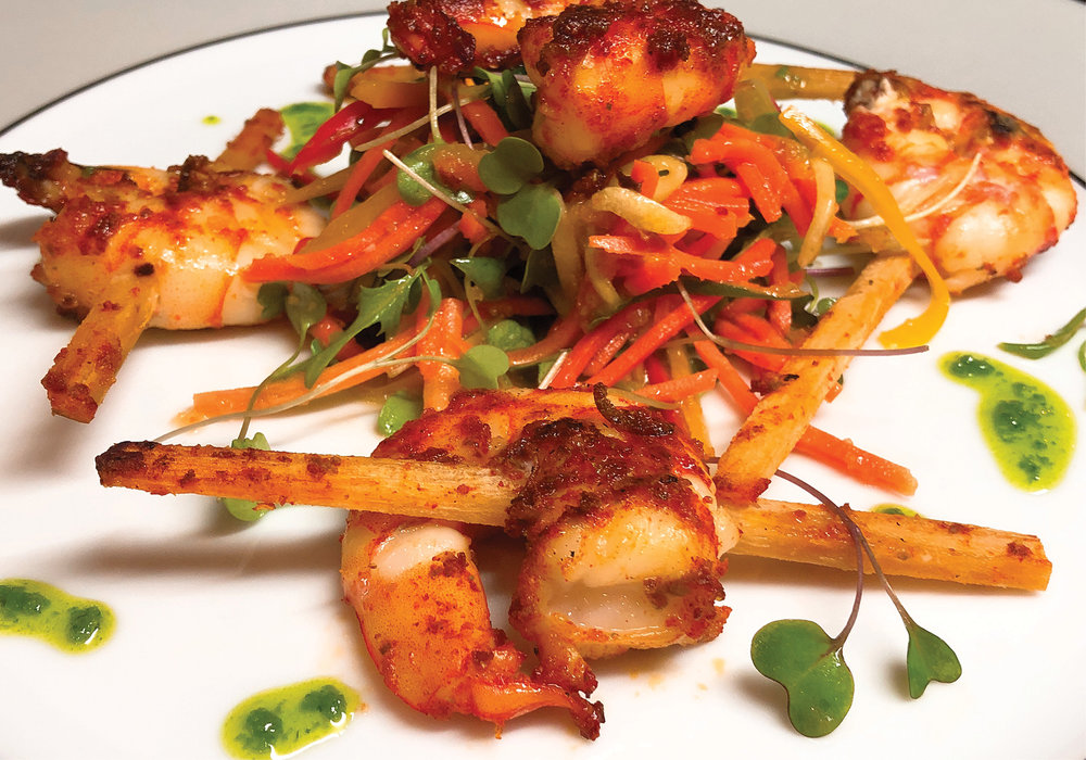 Sugar Cane Skewered Tiger Prawns Marinated in Lemon Zest and Paprika on Asian Slaw