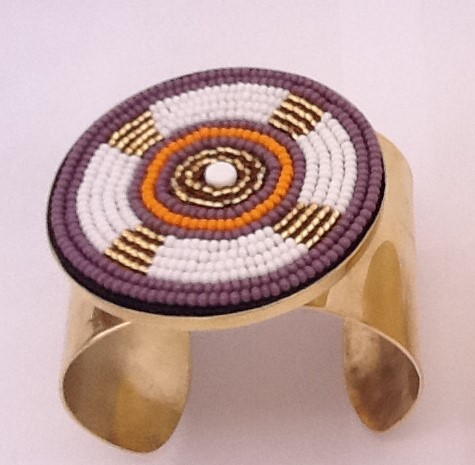 Purple and yellow orange brass bracelets.jpeg