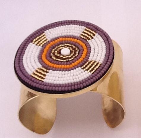 Purple and yellow orange brass bracelets.jpeg