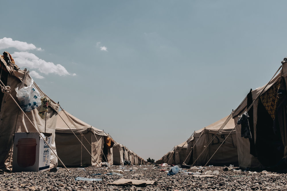 "Home to over 170 families, these makeshift tents will be where they will stay for the foreseeable future, with no known date for release. According to a directive issued by Mosul's district council, they will be allowed to leave once they have shown signs of psychological and ideological rehabilitation. A report by Human Rights Watch from July 13th stated: ""International law requires that punishment for crimes only be imposed on people responsible for the crimes, after a fair trial to determine individual guilt. Imposing collective punishments on families, villages, or communities violates the laws of war and amounts to a war crime."" Iraq. July 12"