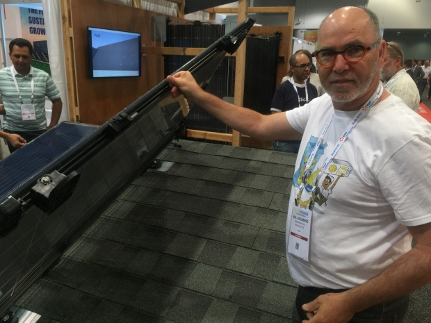 Neil Goldberg, co-founder of SMASHsolar, shows off design that he says can save up to a third of the install cost of other systems. (photo by Kim Brunhuber/CBC)