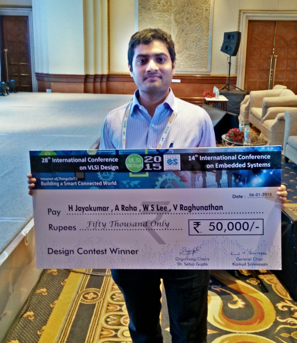 Me with the MVP/MoM style cheque that we won for the design contest Award at the IEEE International Conference on VLSI Design (Jan. 2015)