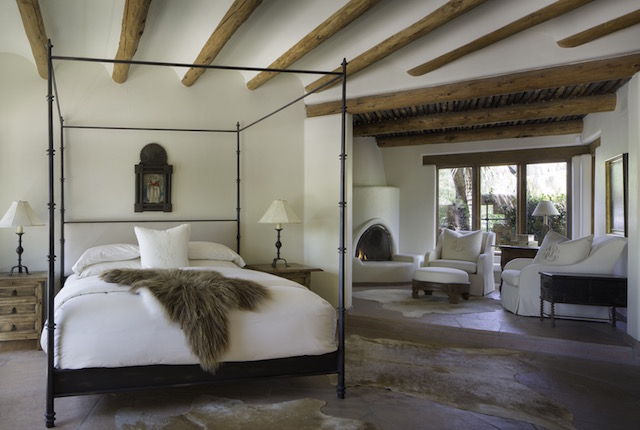 In this historically accurate hacienda bedroom, our client purchased great Mongolian fur throws and cowhide throws to make for a natural surrounding, similar hides can be found at Cowhide International.