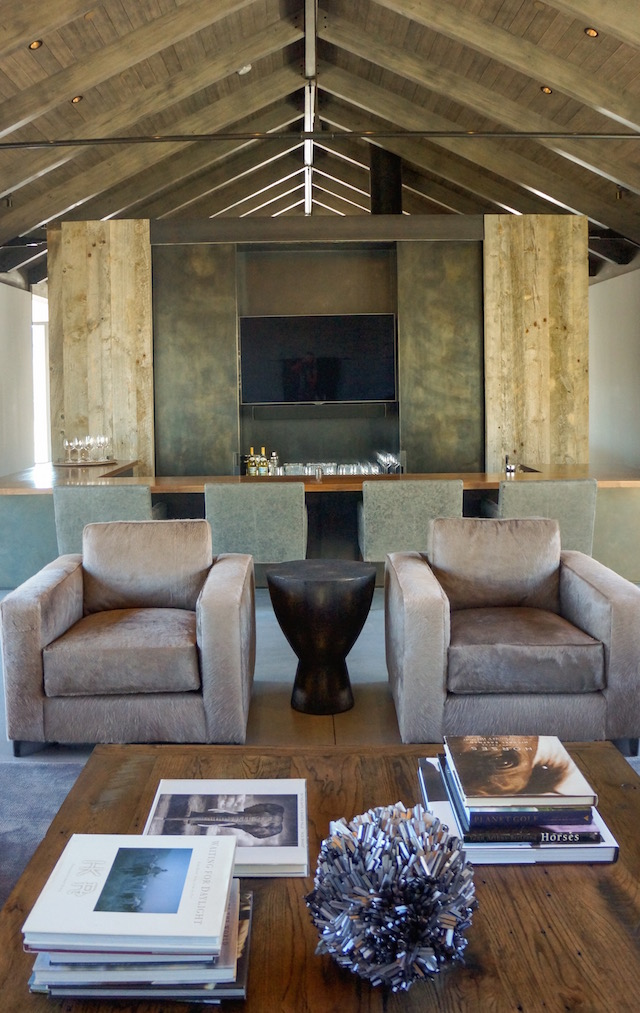 Using warm   neutrals   to complement the outside mountain surrounding these custom made chairs use   Kyle Bunting   cowhide to make a subtle statement of luxury.