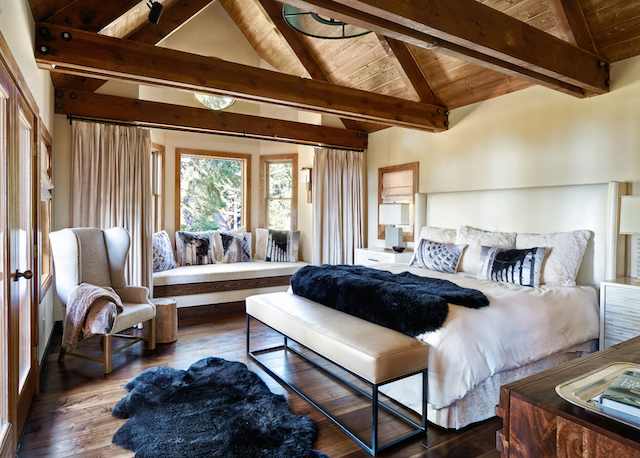 In this modern bedroom we used faux fur to warm up the interiors. The fur back pillows are from Restoration Hardware and the throw is custom made using Overland skins.